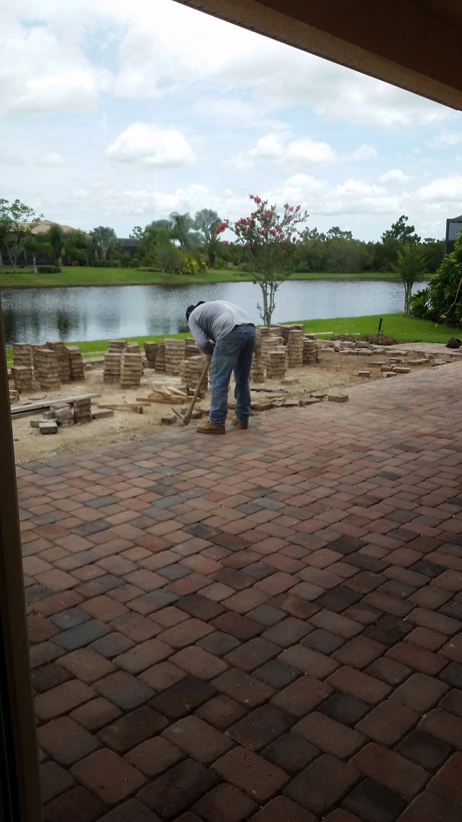 Here's the worker from MD Construction doing a more expeditious removal of the pavers.