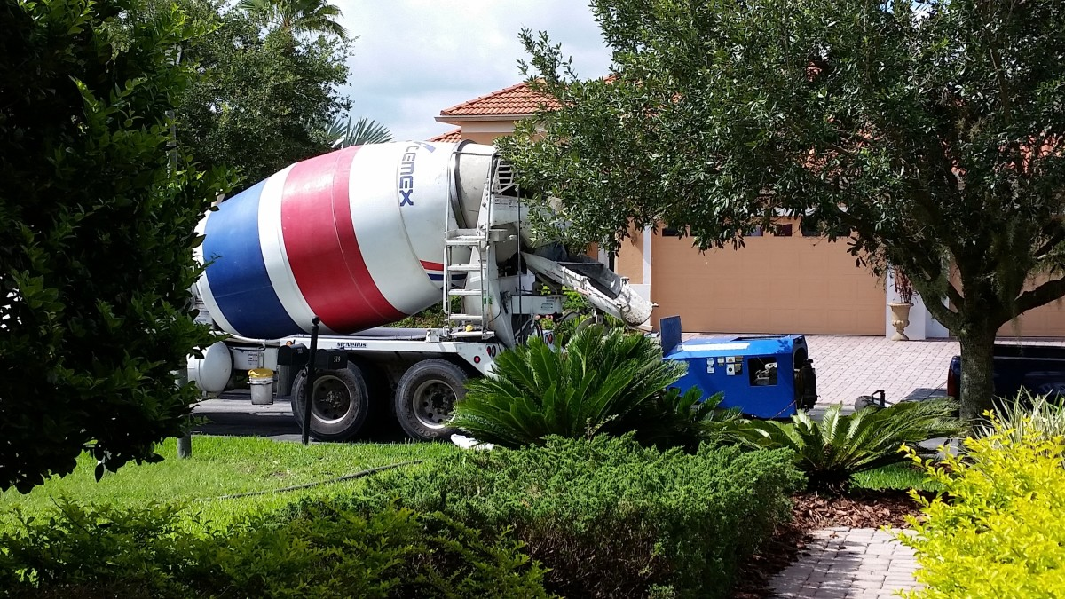 For our size of patio, it took 3 cement trucks plus a small unit that pumped the concrete through large, flexible tubing to our backyard.