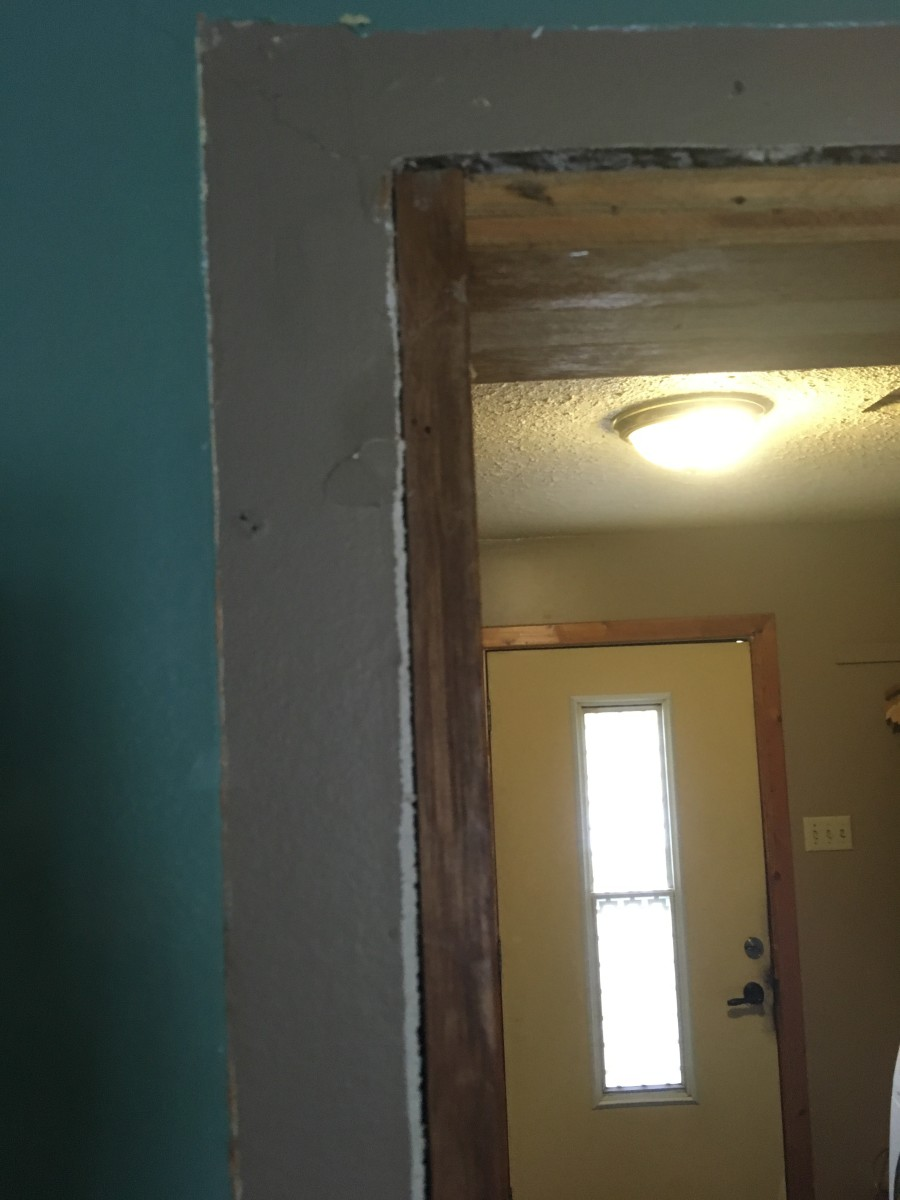 After. Measure from the corner of the doorway down to the floor to get the exact length of the trim piece you need.