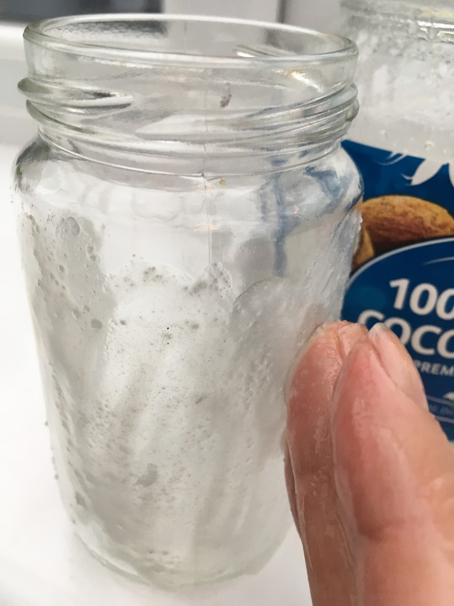 Rub a layer of oil over the glue residue