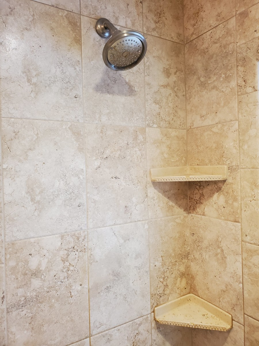 How to Remove Hard Water Stains From Shower Tile and Glass