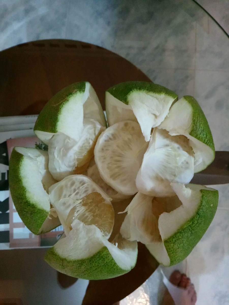 Pomelos are sweet, nice and fragrant. They are covered with a thick layer of skin that needs to be peeled off before you can eat them.