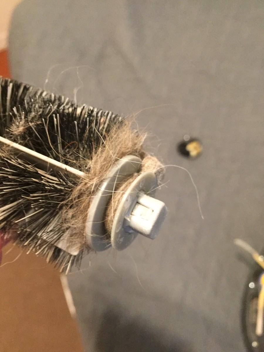 More hair wound around the brush