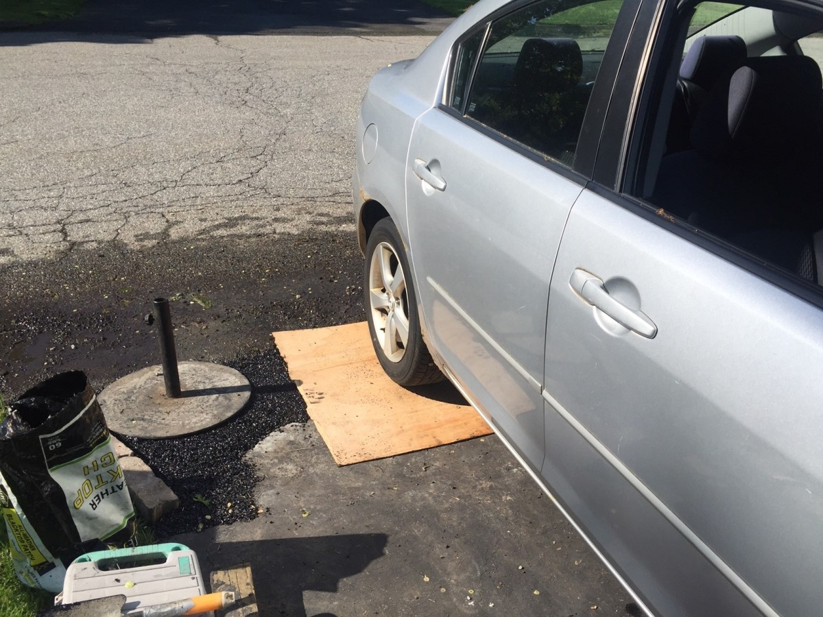 Use your vehicle as a weight source to press down and pack the patch.