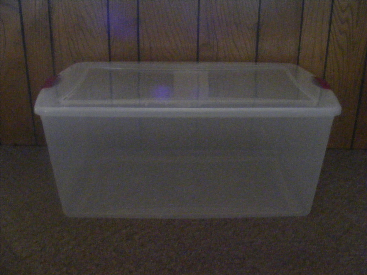 105-quart plastic, transparent storage bin.