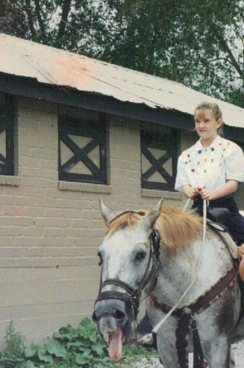 My middle daughter starting out on a trail ride.