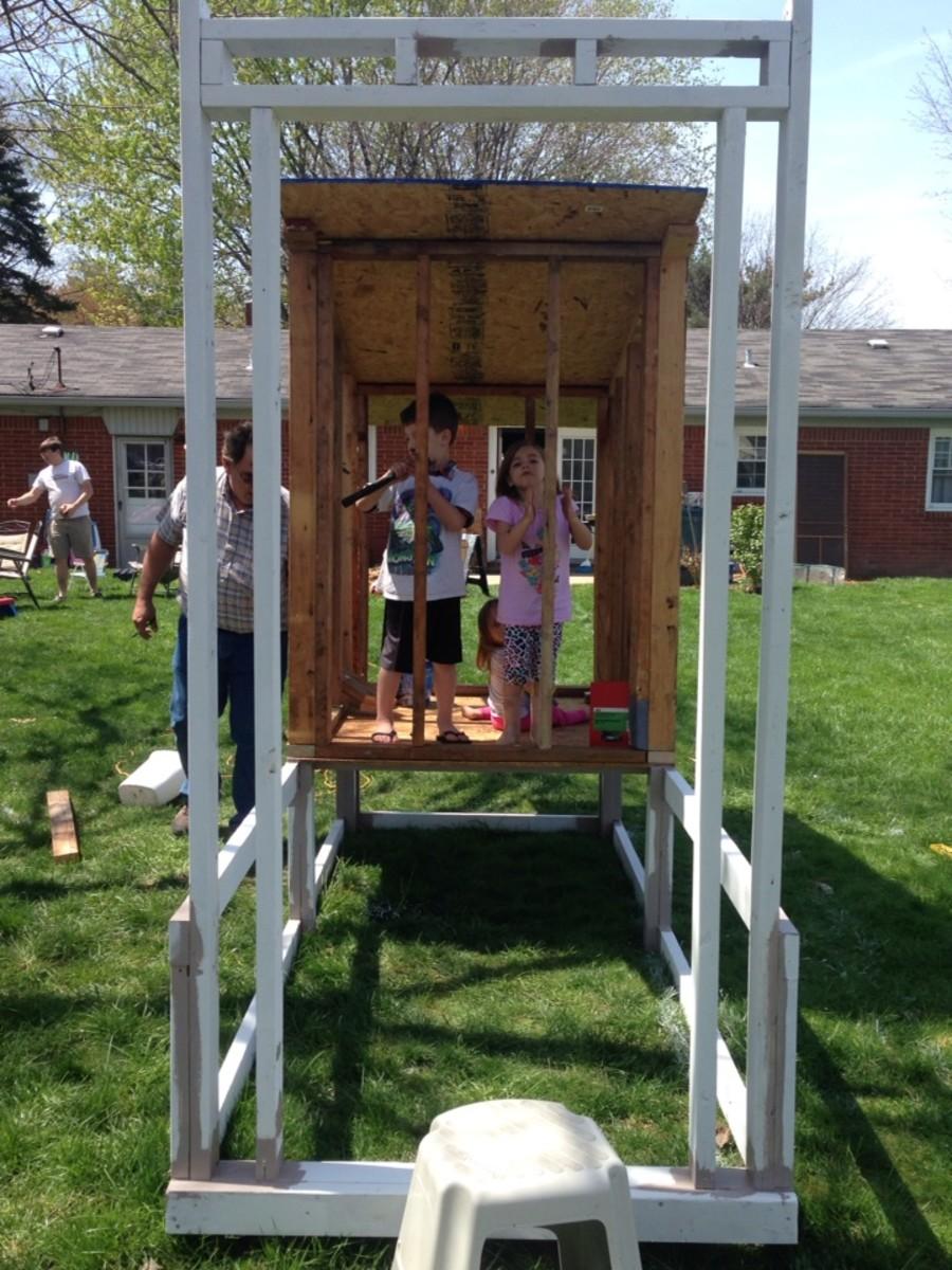 View from the door side of the coop/run.  We had a wood screen door that we are repurposing as a door for the chicken run.