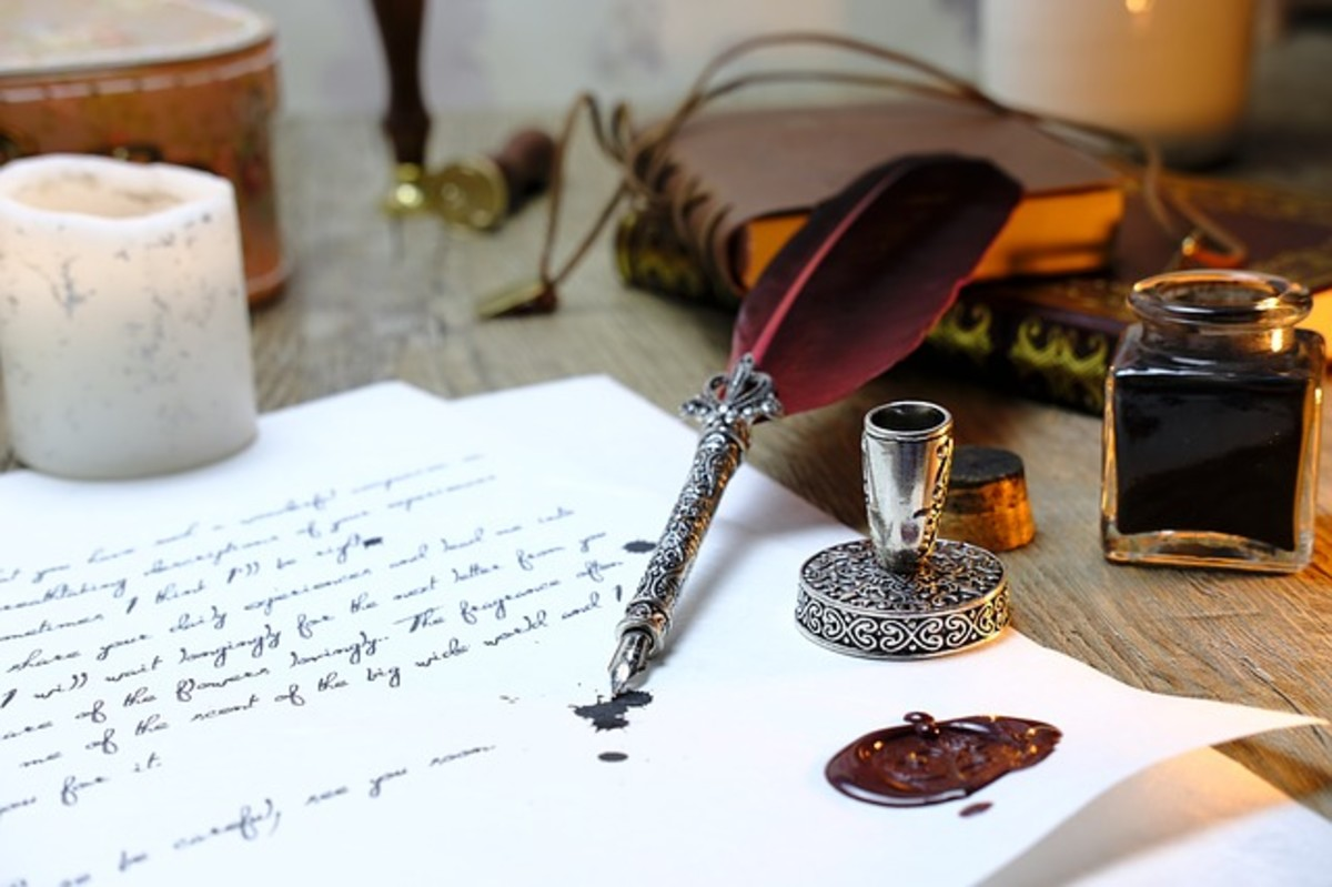 Metal quill and paper