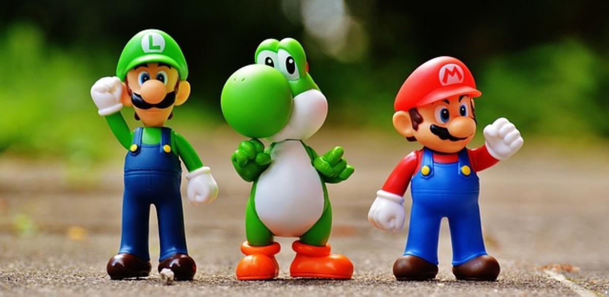 Luigi, Yoshi, and Mario figures