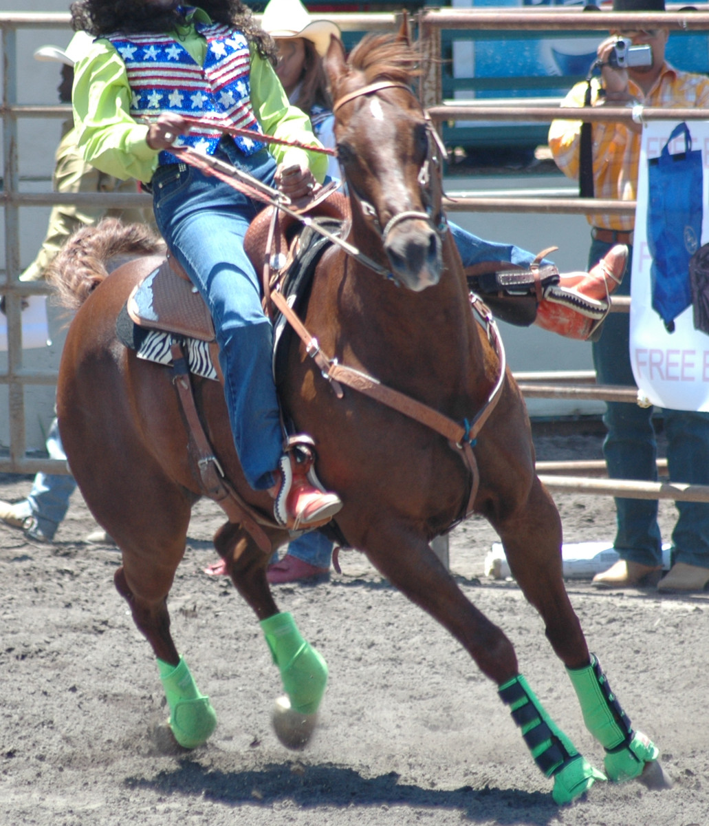 In barrel racing horses and riders must learn to lean in to tight turns.