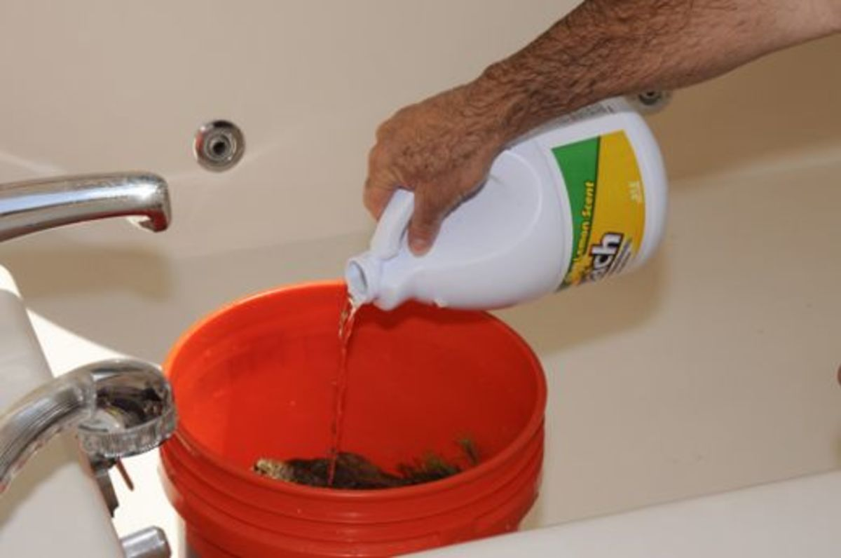 Use approximately 1/2 cup of bleach to your 5 gallons of water. Try less and determine if it works as well.