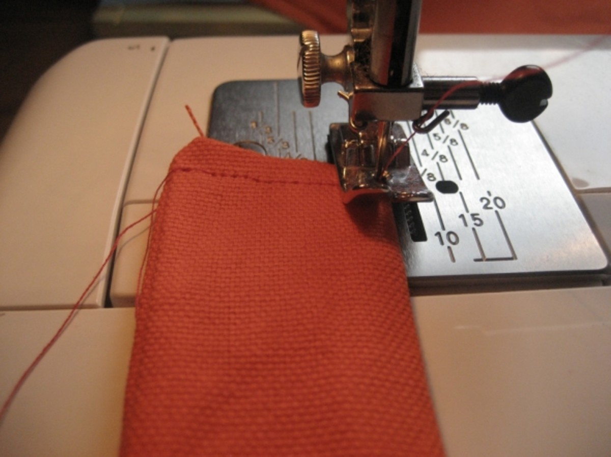 Step 2. Fold the fabric rectangle in half lengthwise. Sew two sides closed, leaving short bottom side open.