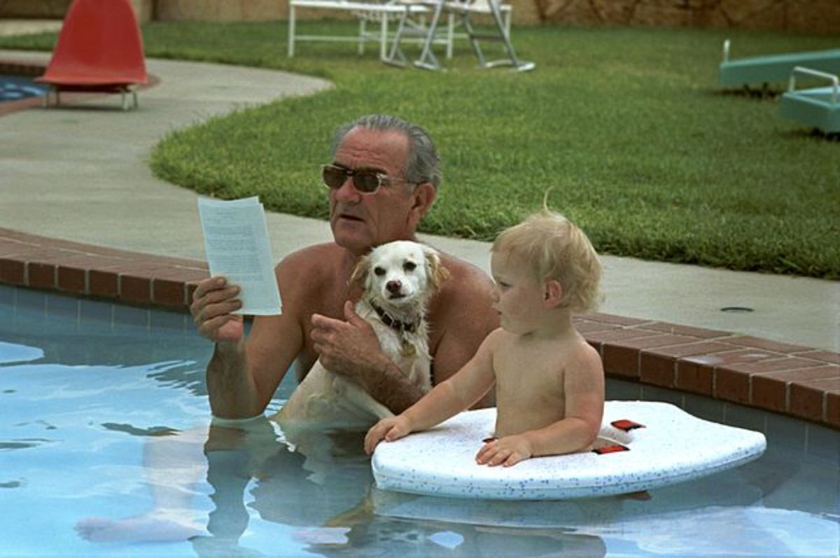 Lyndon B. Johnson holding Yuki, his mixed breed dog.