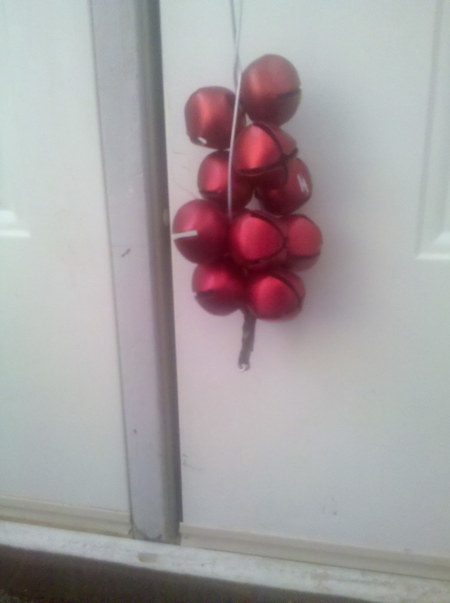 Sleigh bells strung on thick wire with electrical tape wrapped on the sharp ends.