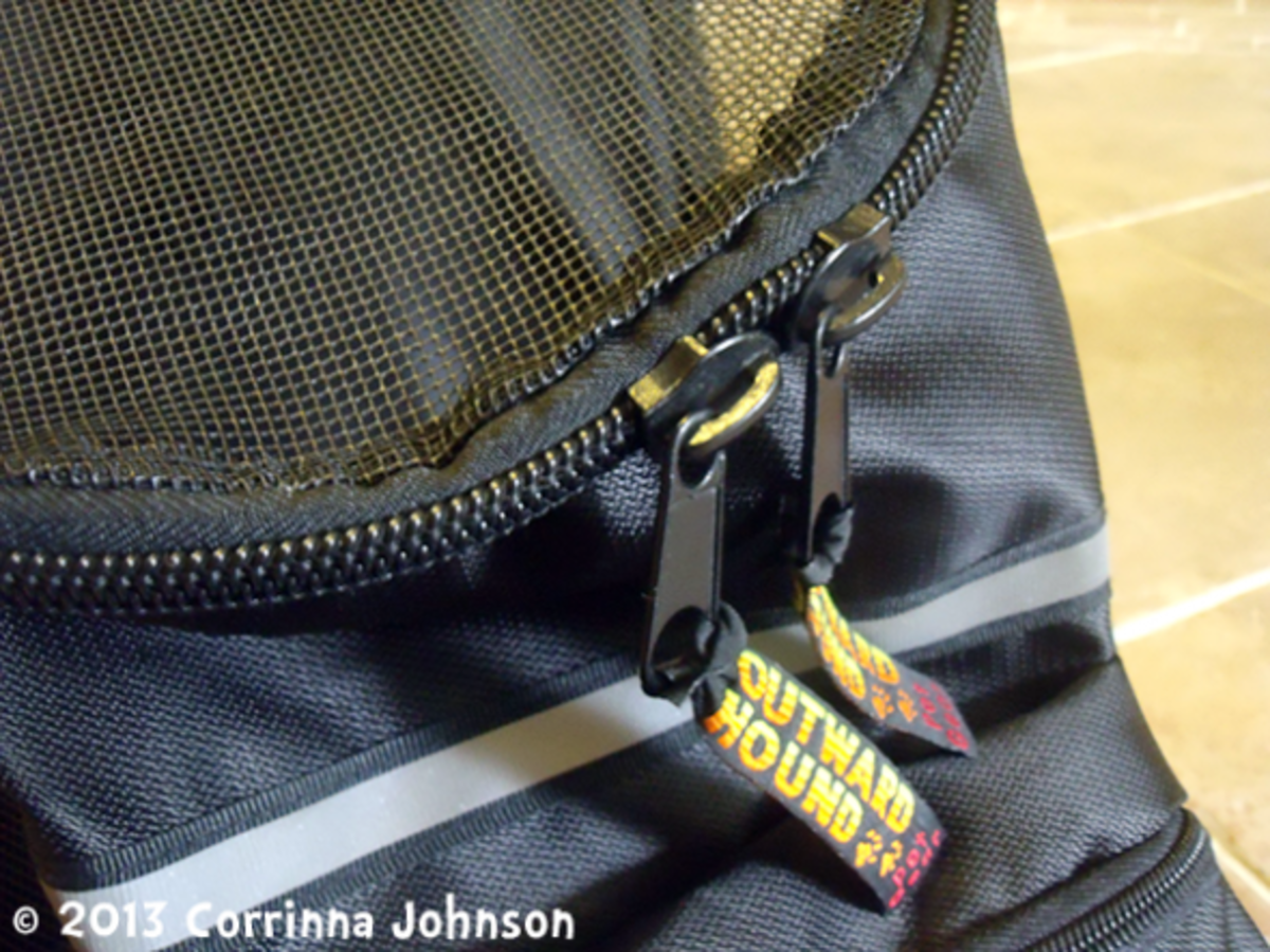 The backpack has double zippers for easy manageability.