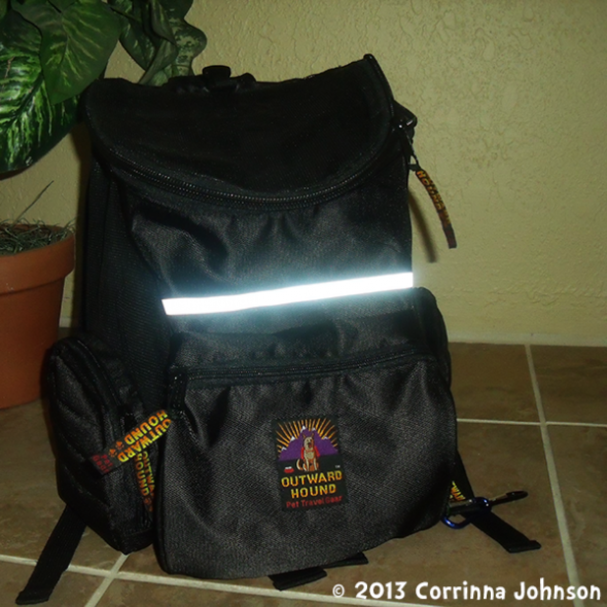 The Bag Has A Reflective Strip Across The Front