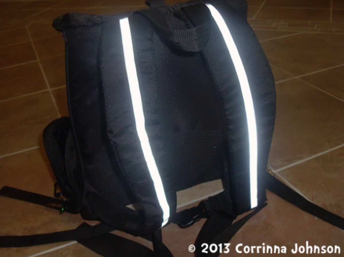 The backpack has reflective strips on the shoulder straps.