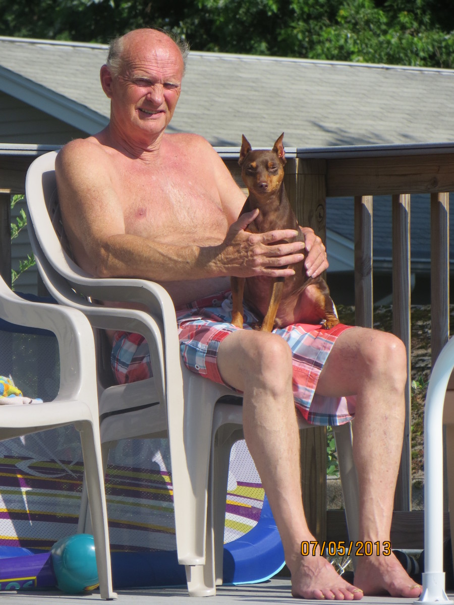 Buzz resting by the pool with my hubby.