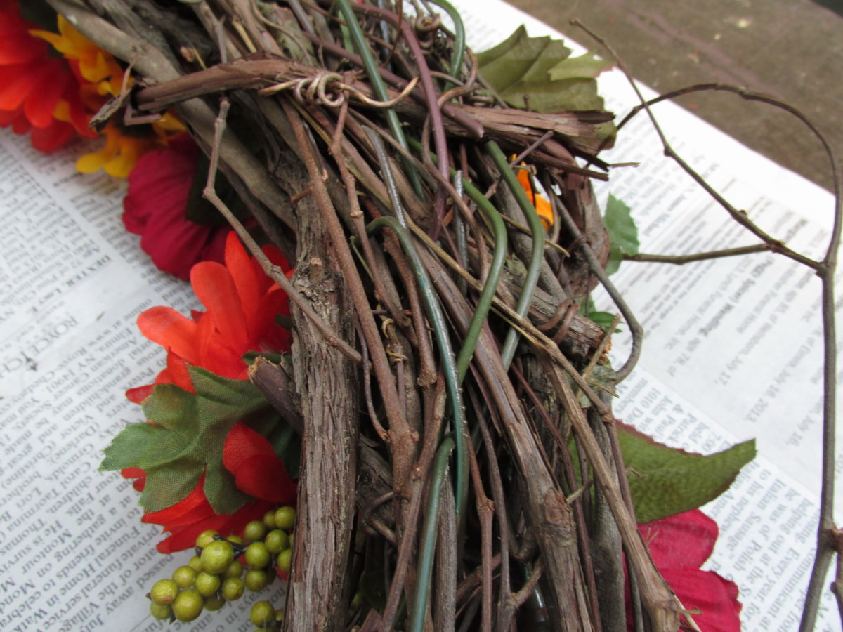 Flower stems woven into the back of the grapevine wreath.