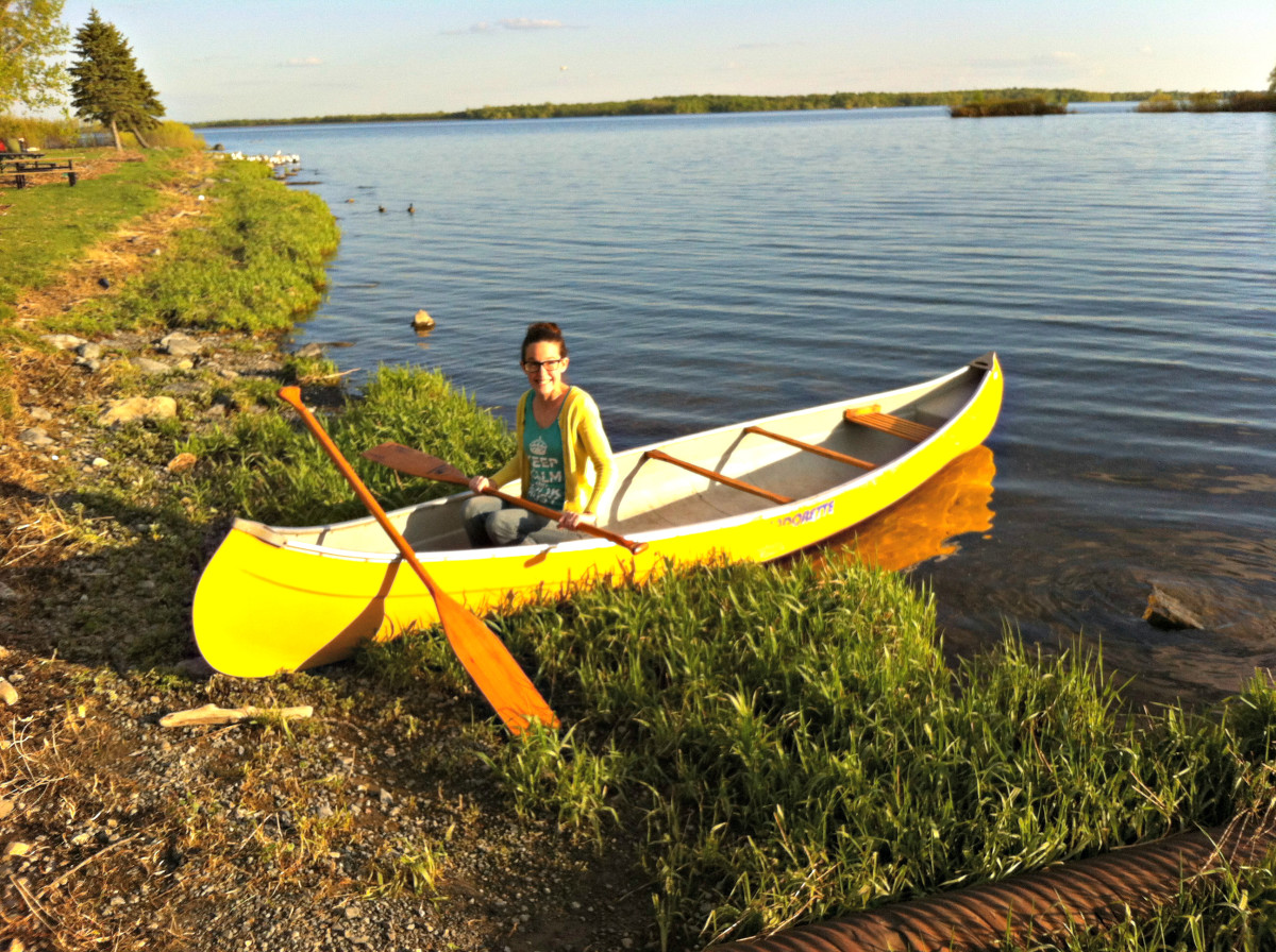 """Me (JessBraz) getting ready to paddle out in """"Old Yeller"""" my yellow fibre glass canoe."""