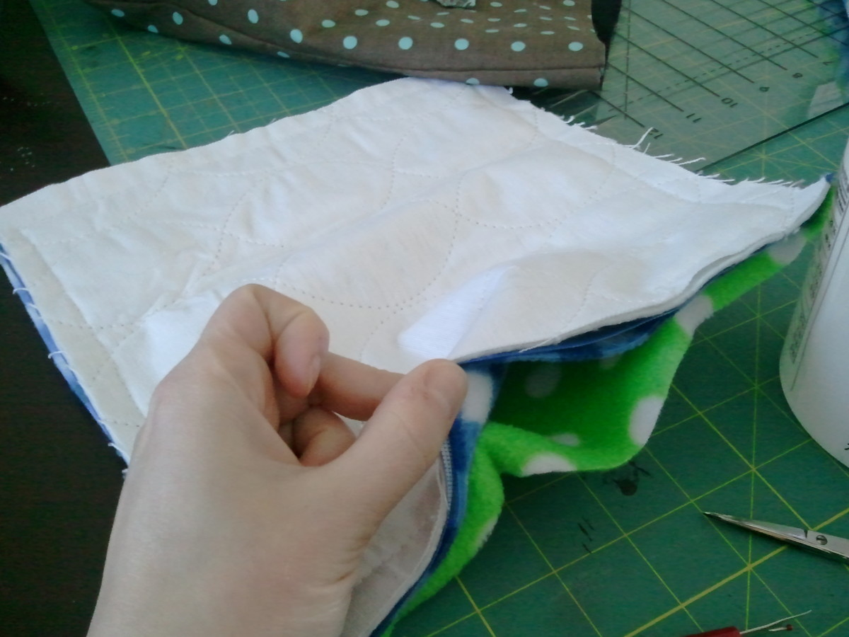 Pieces sewn together. Leave an opening to turn the piece inside out.