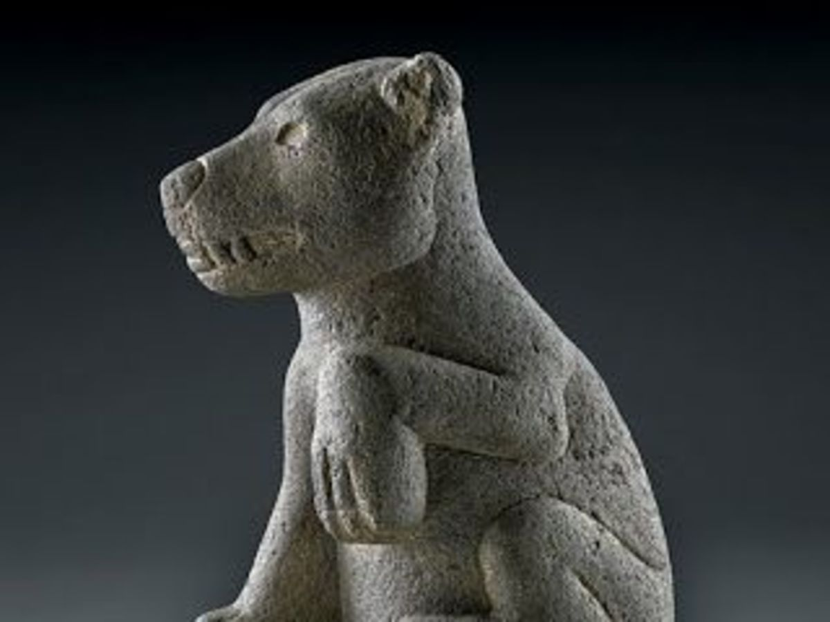 Mayan Chihuahua Statue. This statue, found on Easter Island, resembles the dog statues in ancient Aztec ruins. Note the raised paw.