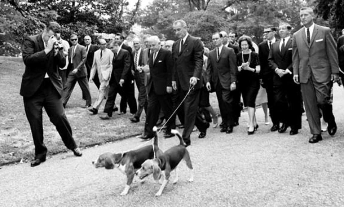 Him and Her walking with LBJ.