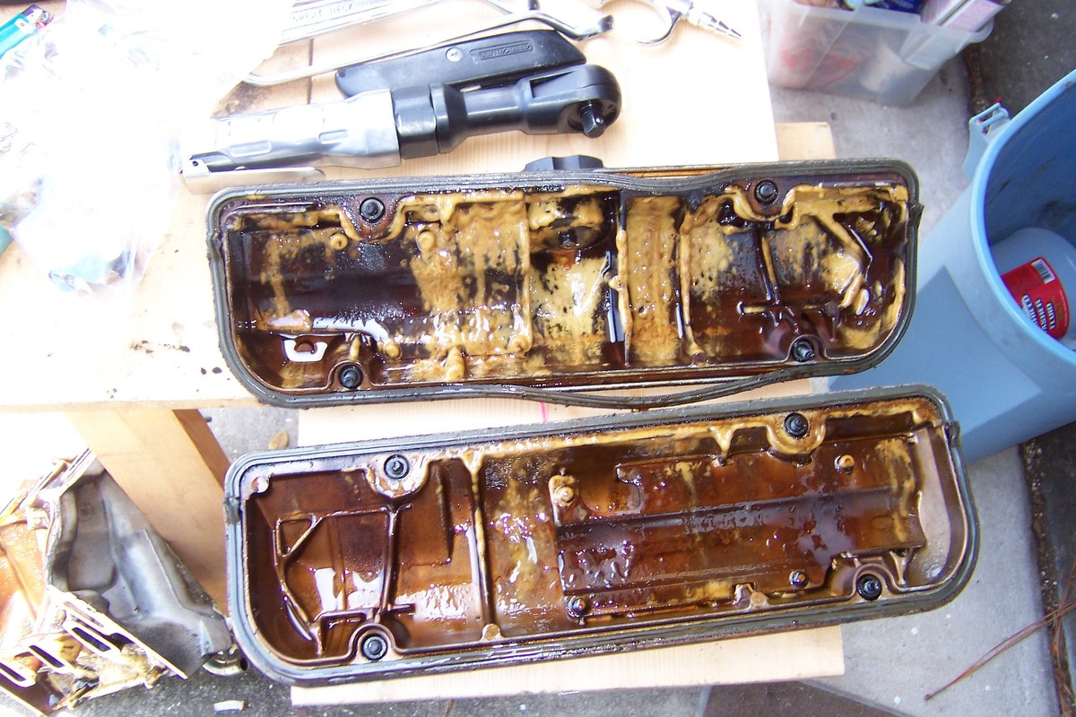 Valve covers after removal.  The yellowish creamy gunk means coolant has gotten into the oil.