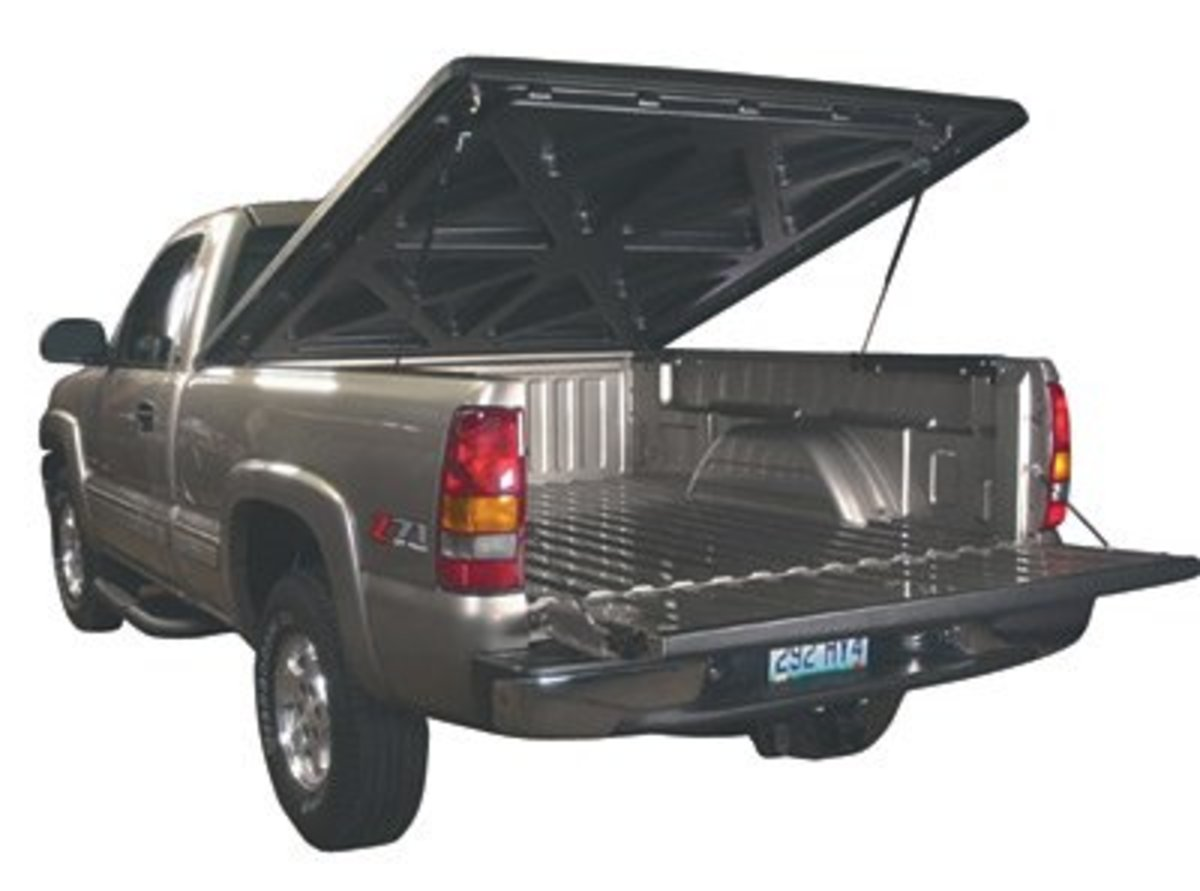 A bed cover can cut drag and increase gas mileage on a full sized Chevy truck by as much as 1 MPG.