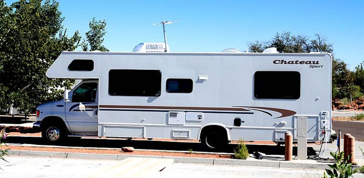 Class C motorhome; the drivers compartment is narrower and shorter than the rest of the RV.