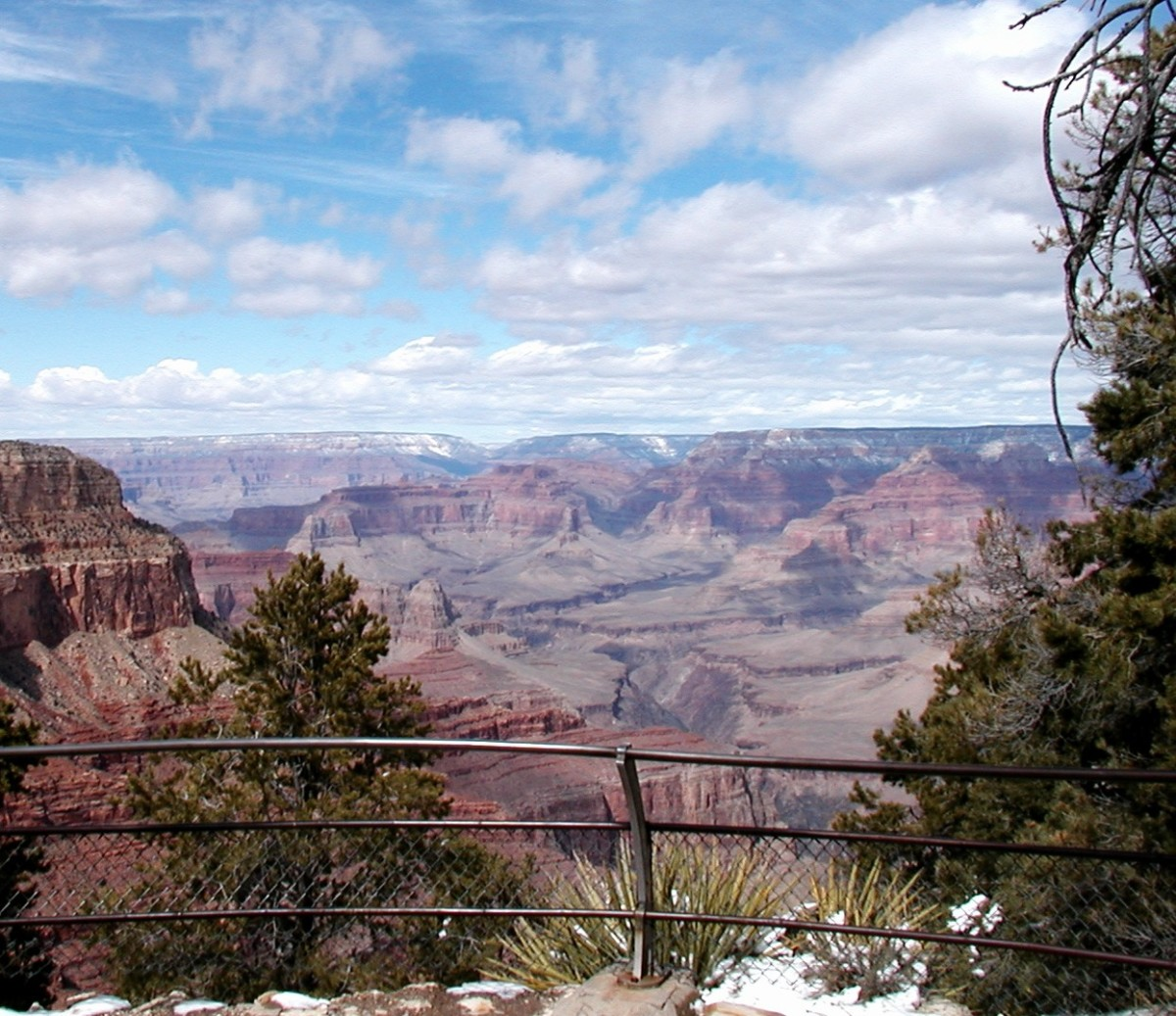 """Path along the top of the Grand Canyon with a pipe """"safety"""" rail."""
