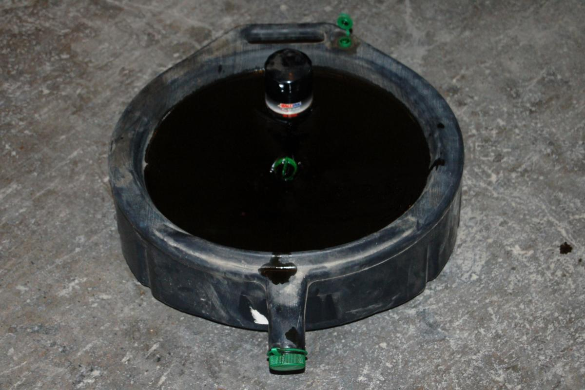 Bring your oil drain pan to your local auto parts store and they'll recycle the oil for you.