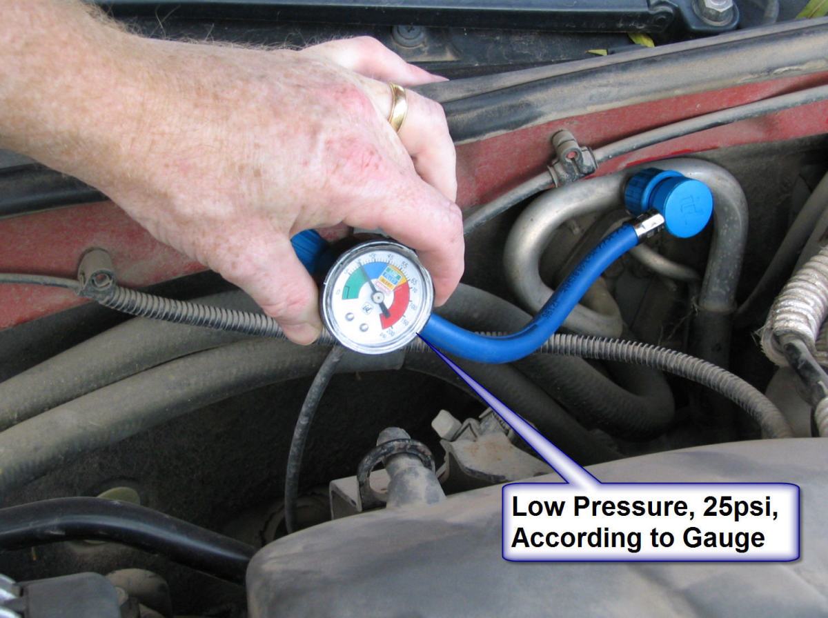 Measuring pressure with the hose and gauge.