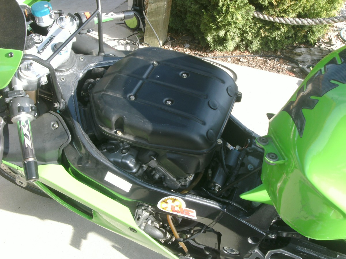The gas tank has been rotated to the rear of it's normal position and the air cleaner exposed.