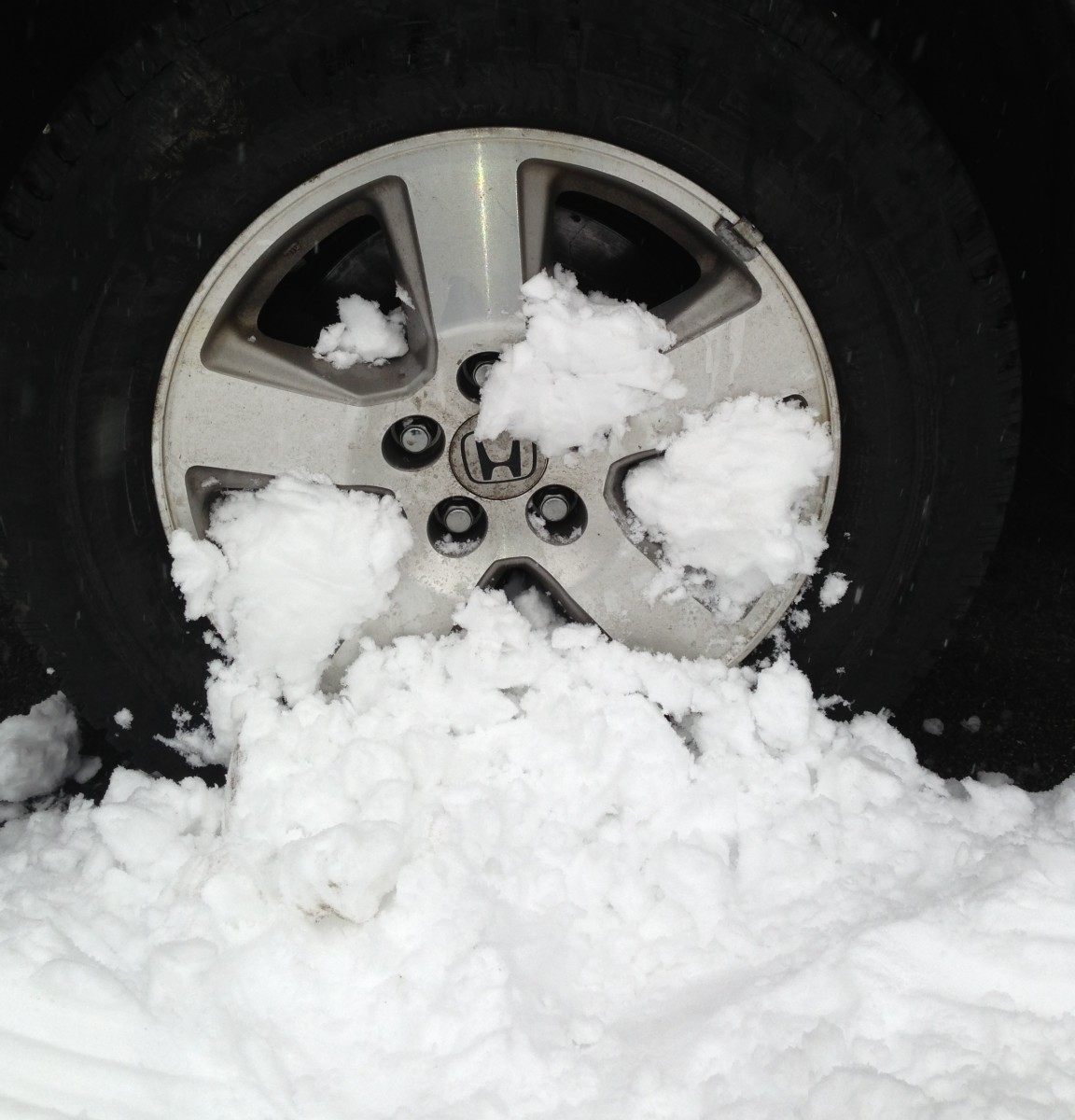 If you drive through a snow bank and have a horrible vibration soon after, check your wheels for packed snow and ice.