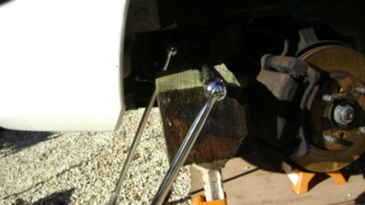 Use a jack stand or another other support tool before attempting to loosen the crankshaft pulley bolt.
