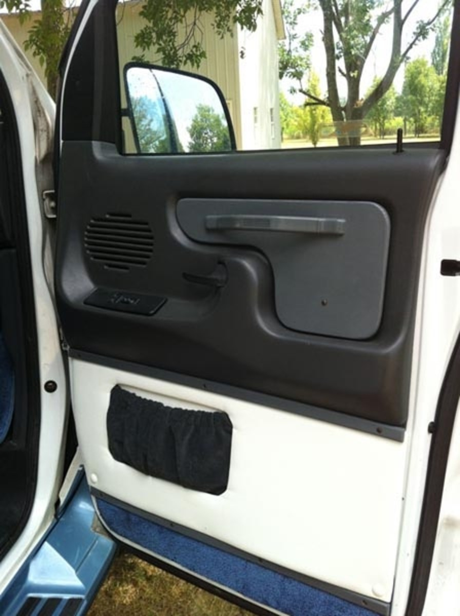 New door panel upholstery invite you inside.