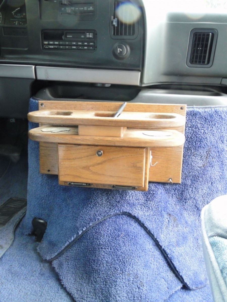 "No glove compartment; just this ""upgraded"" wood console whose cup rests are so shallow they release your commuter mug right into your lap on turns."