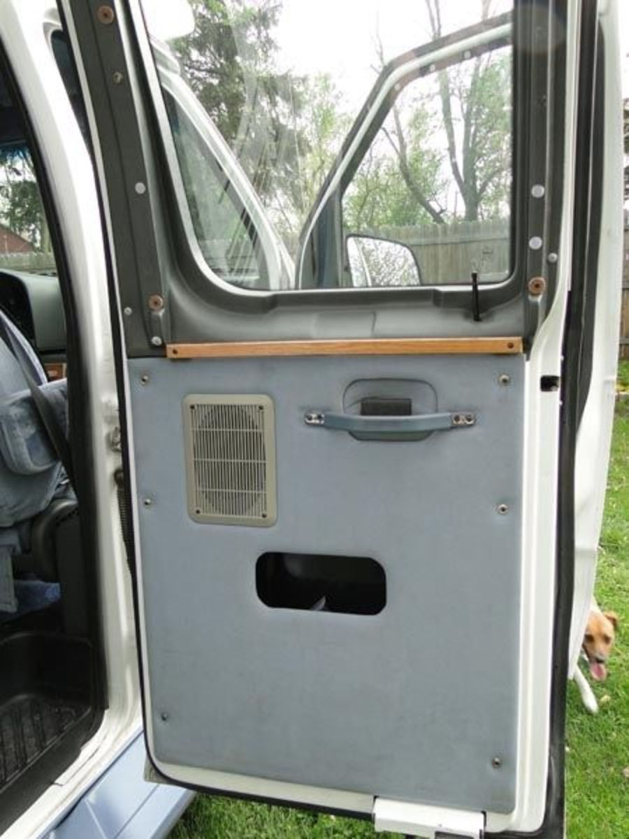 BEFORE: The back door on the passenger side is where most of the action in and out of the van happens. There were so many mismatched dirty elements to clean up; handle, curtain rods, speaker cover...