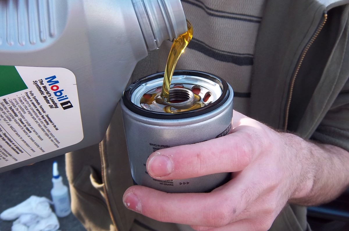 Priming the filter with oil prevents a dry start when you first crank the engine on.