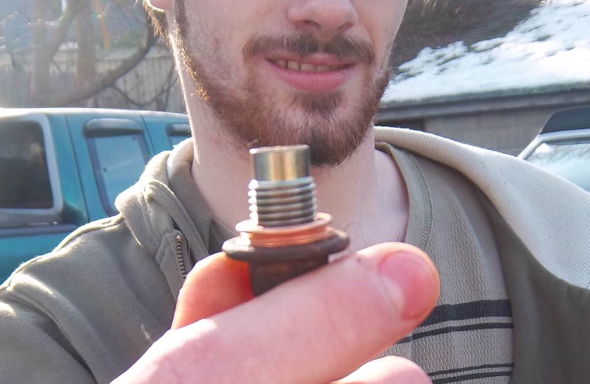 """Oil drain plug; €""""clean and ready to be installed."""