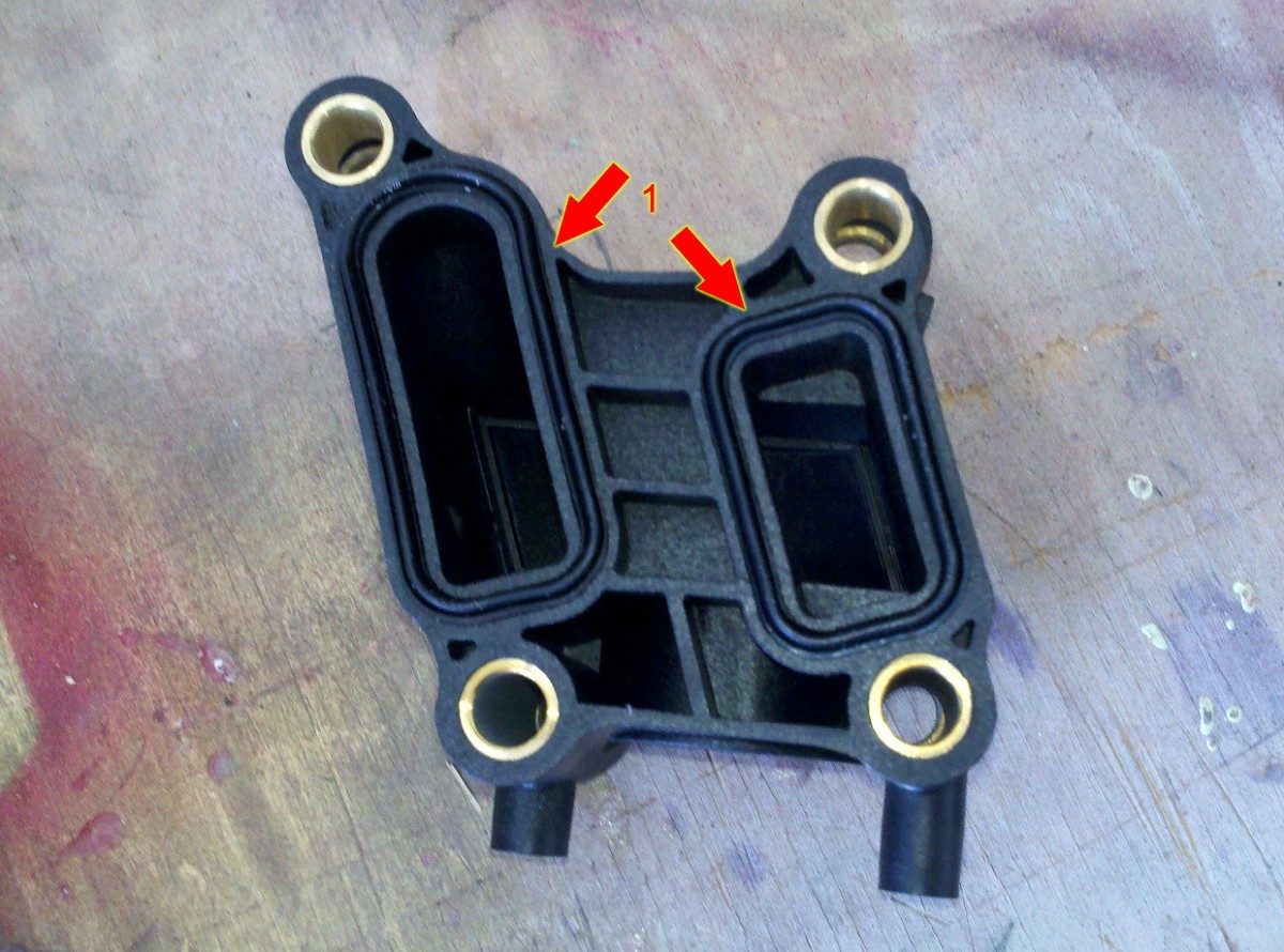 how-to-replace-a-water-coolant-housing-outlet-on-a-dodge-charger-2006-2009-with-27l-engine