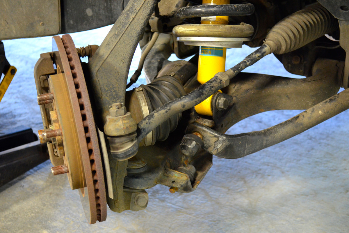 Carefully turn the wheel outward to gain enough space to work on the sway bar link.