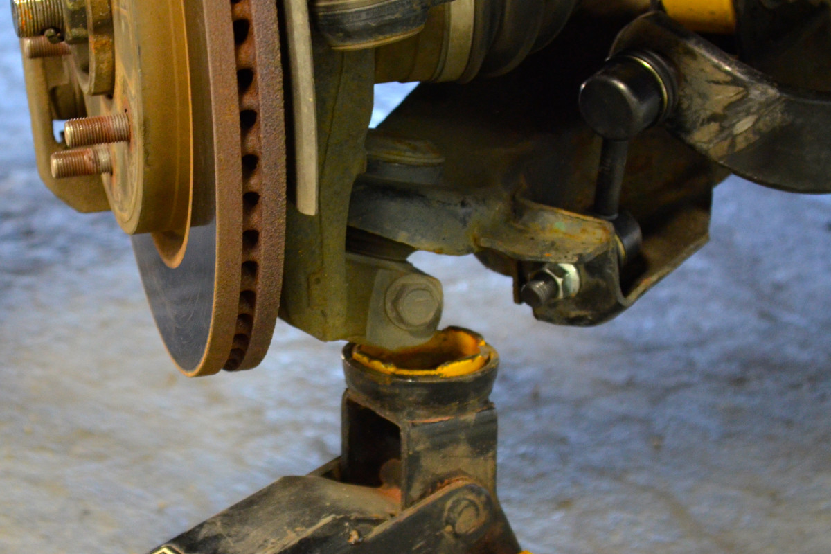 Insert the new sway bar link, being careful not to ding the threads. A jack may need to be used to raise the lower control arm into position. The bolts of the links should slide right in.