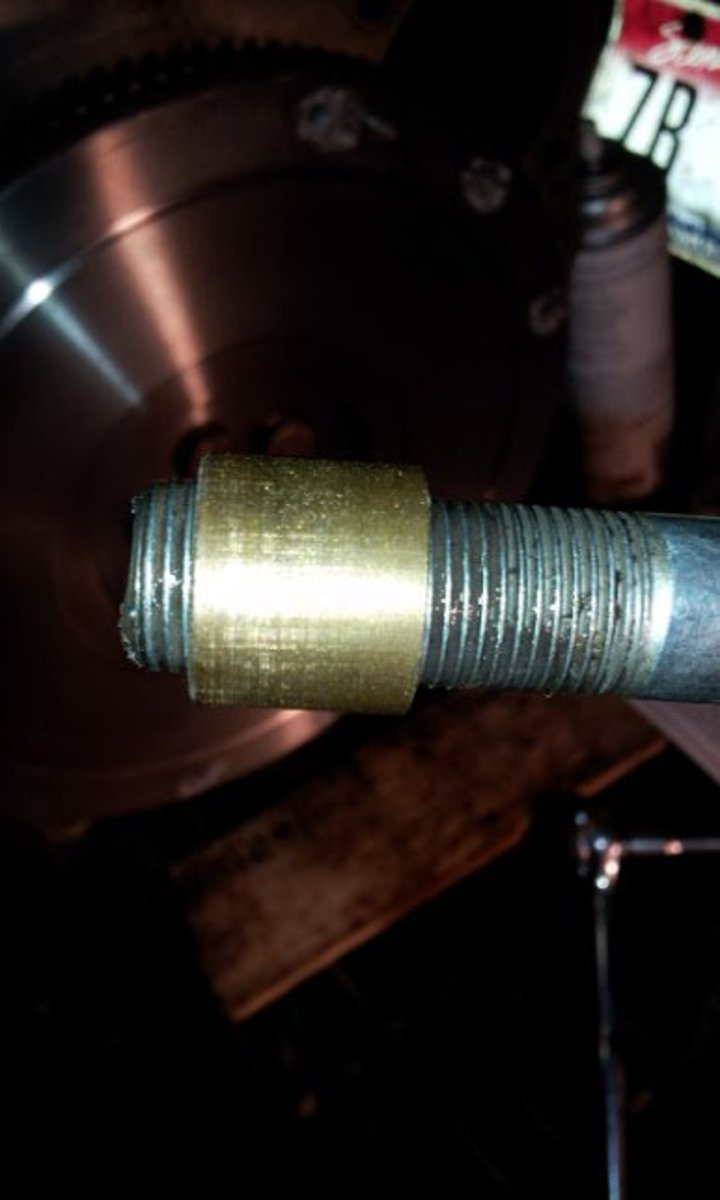 Pilot bushing on a bolt used to pop it out.