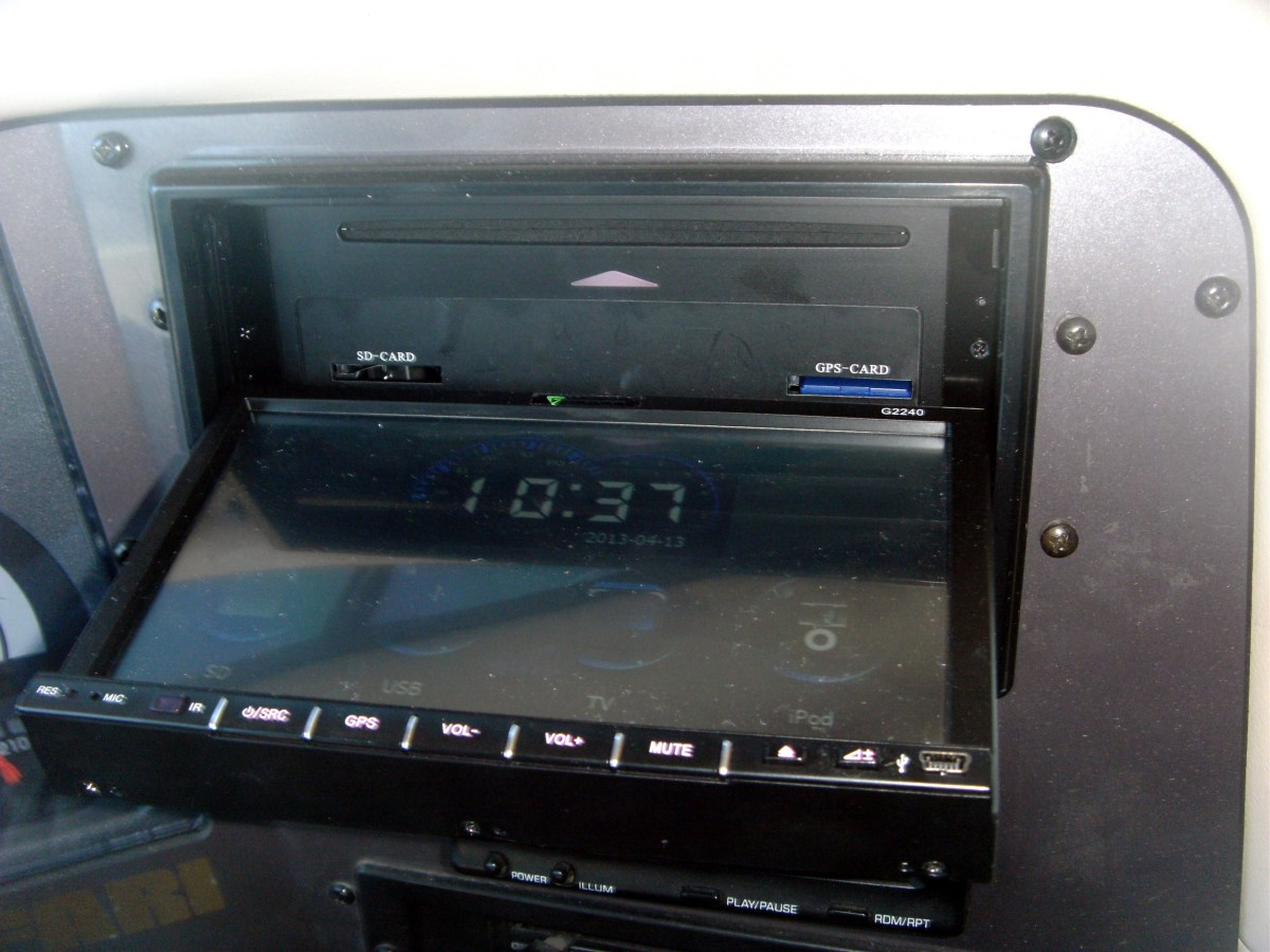 Lowering the motorized screen reveals the DVD slot as well as SD slots for both the GPS and auxiliary SD slot.