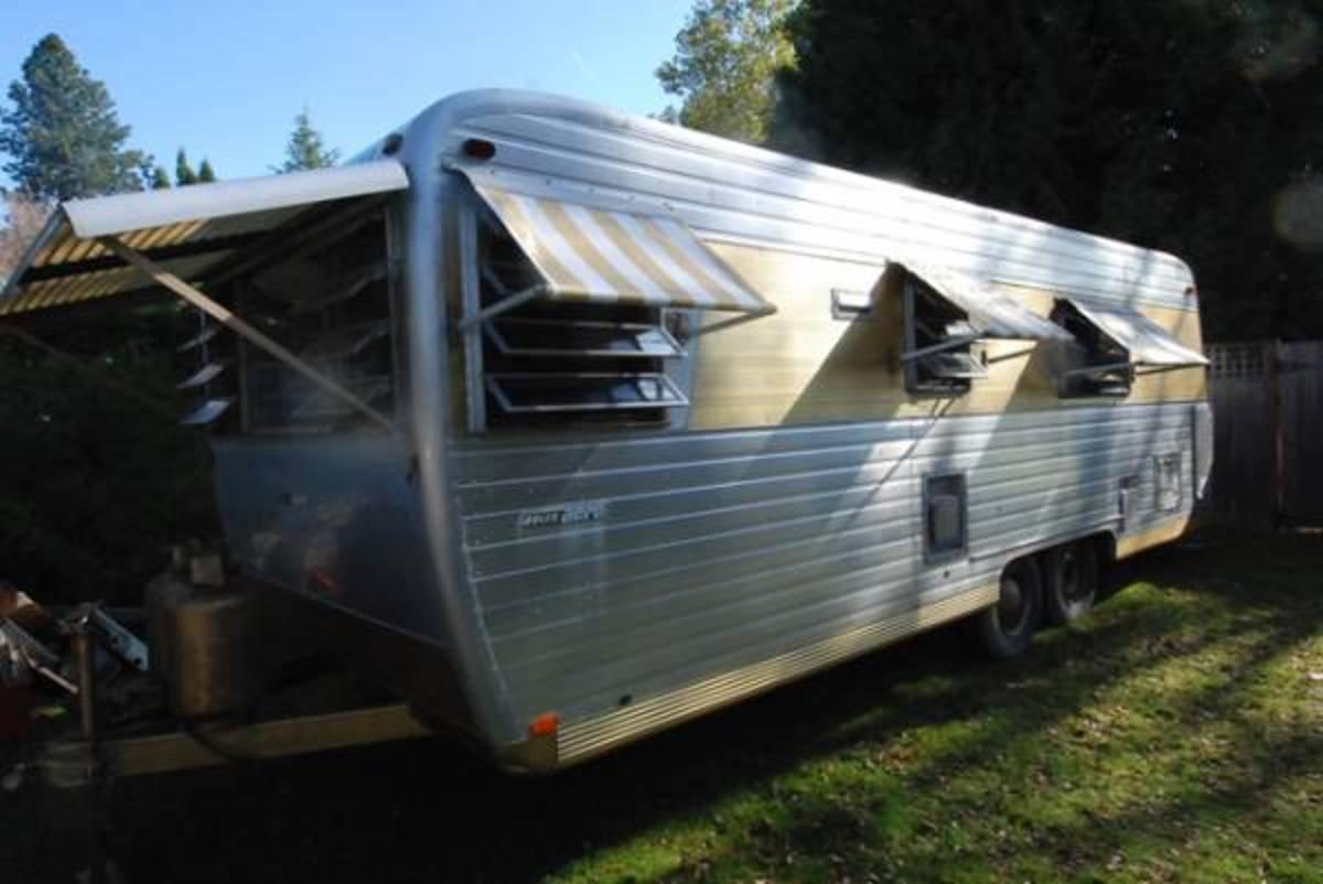 Boles Aero travel trailer sitting on camping spot.