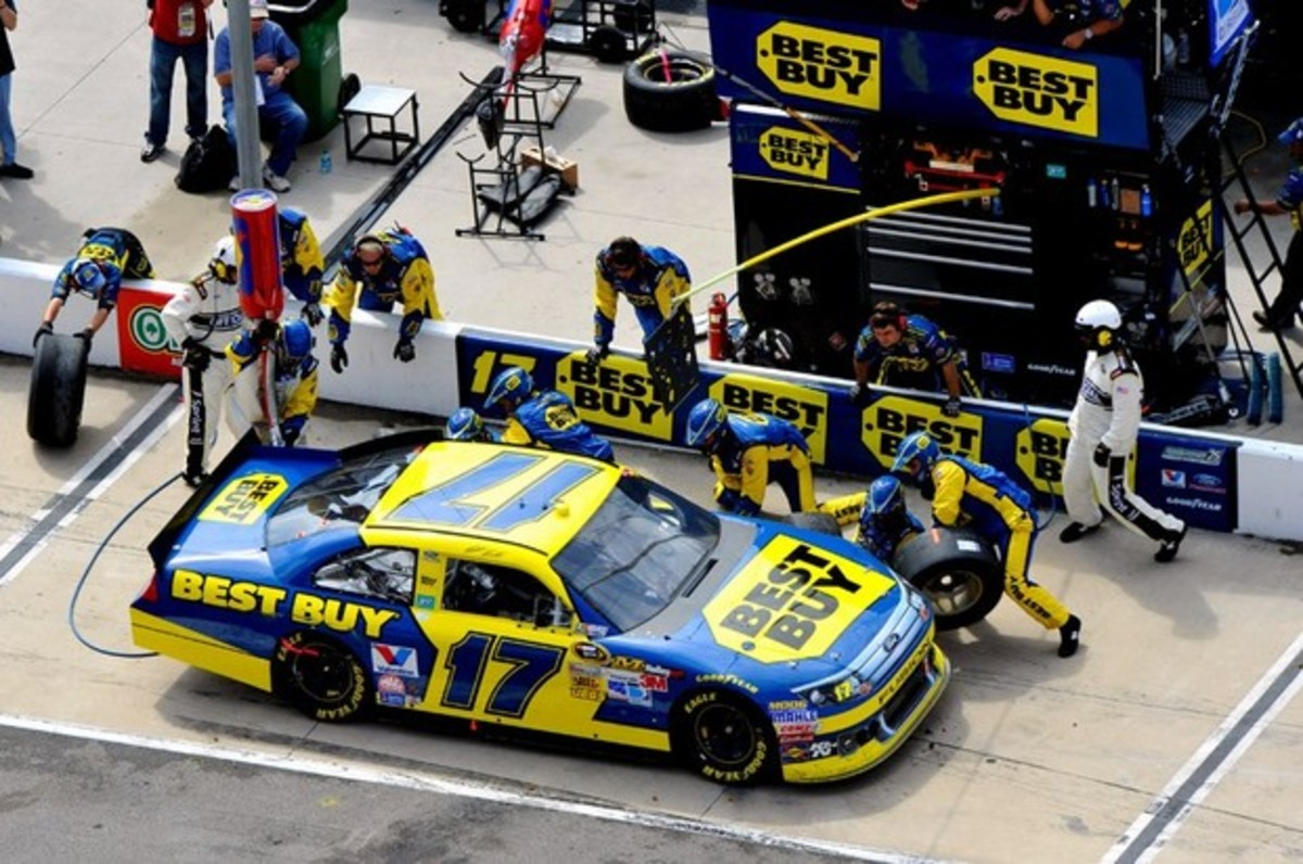The #17 Best Buy car receives service in its pit stall. Notice the painted lines in front and behind the car, representing the edge of the stall