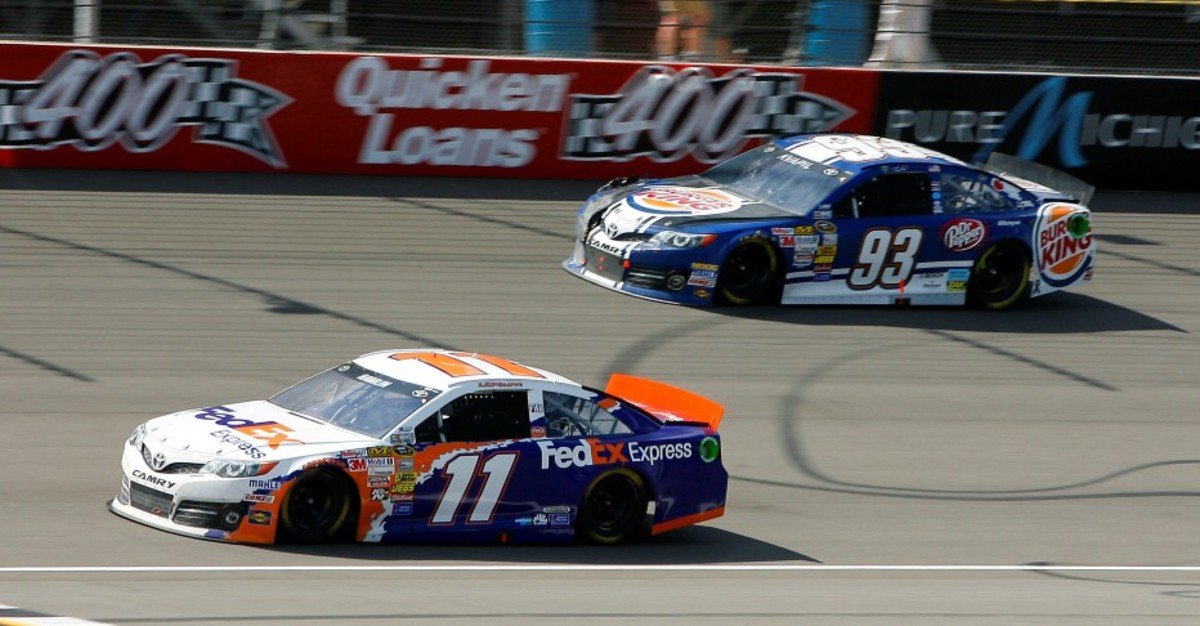 Different cars choose to run different lines on the track. Here, #93 runs the outside line while #11 runs the inside line