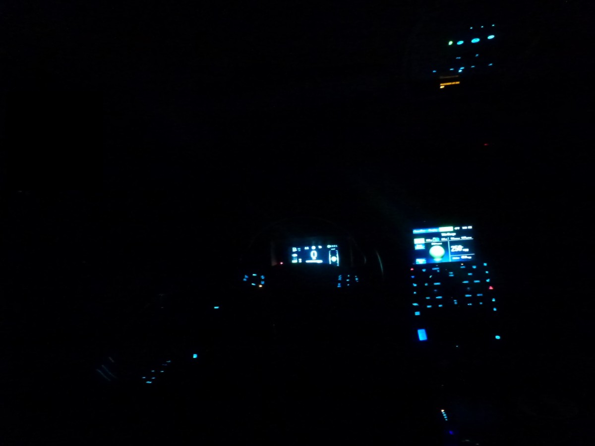 The Chevy volt interior, at night.  Taken from the back seat, looking forward through the drivers area.